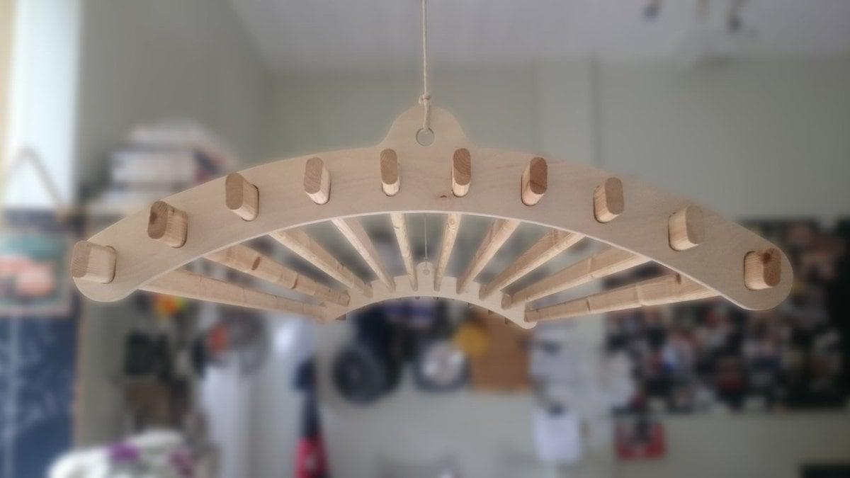 stendibiancheria-soffitto-legno-design