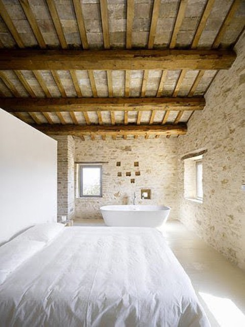camera da letto parete mattoni 21