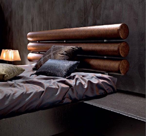 testata letto tronchi legno