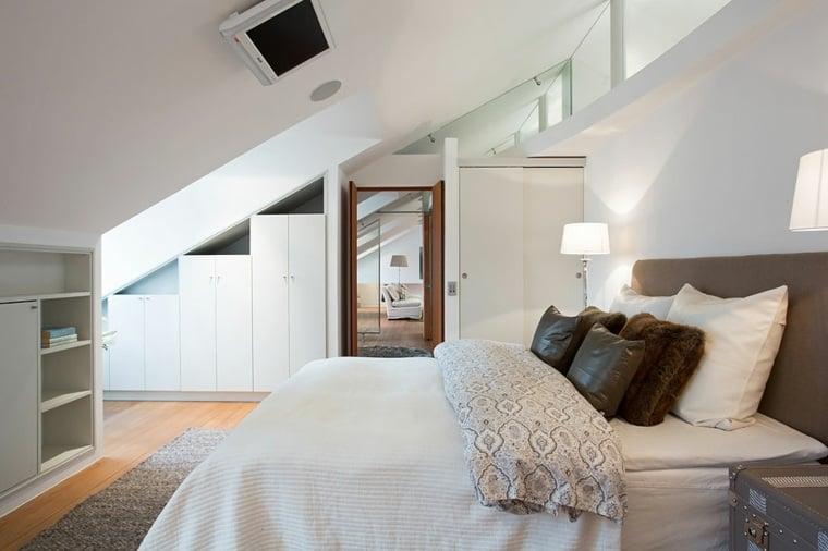 Idee per arredare camera da letto mansardata